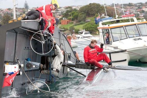 Alt_NSW Maritime standing by capsized Q. Credit w.Sailpix.com.au