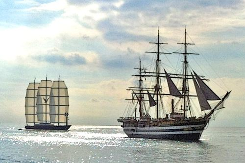 Perini-Navi-charter-yacht-Maltese-Falcon-and-the-historical-tall-ship-Amerigo-Vespucci.jpg-665x639.png