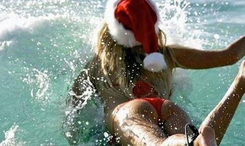 Santas helper loves to surf